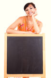 Beautiful female teacher with blackboard Stock Photos