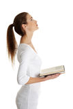 Beautiful female teen with a book. Royalty Free Stock Photos