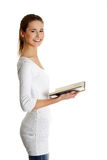 Beautiful female teen with a book. stock photo