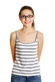 Beautiful female teen with glasses on her face. Royalty Free Stock Photography
