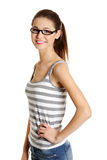 Beautiful female teen with glasses on her face. Stock Image