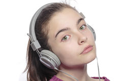 Beautiful female teenager with earphones Royalty Free Stock Images