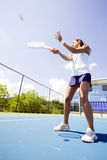Beautiful female tennis player in action Royalty Free Stock Photos
