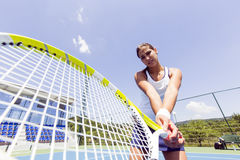 Beautiful female tennis player in action Royalty Free Stock Photo