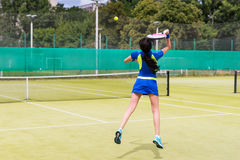 Beautiful female tennis player in action Royalty Free Stock Photography