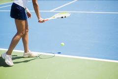 Beautiful female tennis player serving Royalty Free Stock Images