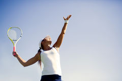 Beautiful female tennis player serving Royalty Free Stock Image
