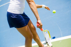 Beautiful female tennis player serving Royalty Free Stock Photos