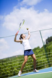 Beautiful female tennis player serving Stock Images