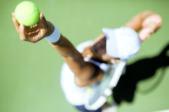 Beautiful female tennis player serving Stock Photography