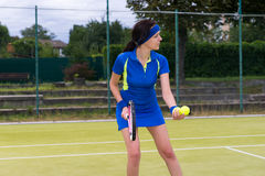 Beautiful female tennis player serving outdoor Royalty Free Stock Photo