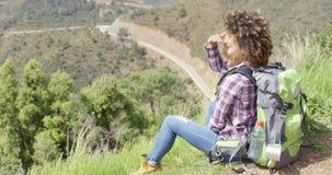 Beautiful female traveler on mountain stock footage