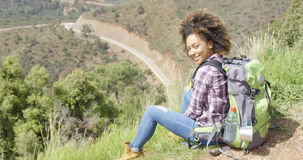 Beautiful female traveler on mountain Stock Image