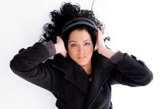 Beautiful female tuned into music Royalty Free Stock Photos