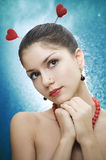 Beautiful female with two hearts Stock Photo