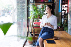 Beautiful female using digital tablet in cafe Royalty Free Stock Photography