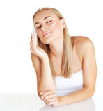 Beautiful female using moisturizer Royalty Free Stock Photo