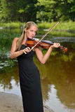 Beautiful female violin player - music series Royalty Free Stock Photos