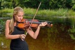 Beautiful female violin player - music series Stock Image