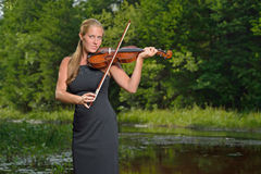 Beautiful female violin player - music series Royalty Free Stock Photography