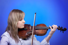 Beautiful female violinist Royalty Free Stock Image