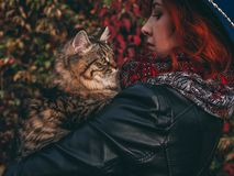 Woman with cat walks in the park stock photography