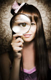 Beautiful female watching through magnifying glass Stock Images