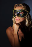 Beautiful female wearing mask Stock Photography
