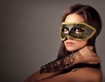 Beautiful female wearing mask Royalty Free Stock Images