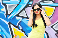 Beautiful female wearing sunglasses. Outdoors stock image