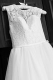 Beautiful female wedding dress with upper part of lace Royalty Free Stock Photo