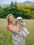Beautiful Female With Cute Little Dog Outdoors Stock Photo