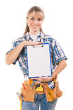 Beautiful female worker showing blank clipboard with white sheet Royalty Free Stock Photography