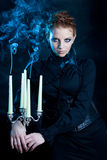 Beautiful females,  girl holds a candle stand Stock Image