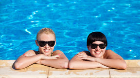 Beautiful females model posing by the pool Stock Photography