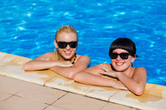 Beautiful females model posing by the pool Royalty Free Stock Photos