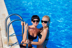 Beautiful females model posing by the pool Royalty Free Stock Photography