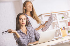 Beautiful females working on project Stock Photo