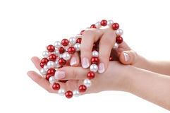 Beautiful feminine hands with necklace Stock Image