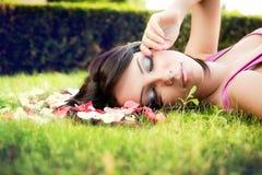 Beautiful feminine woman and flower petals stock images