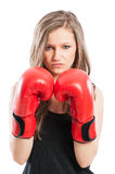Beautiful feminist wearing red boxing gloves Stock Images