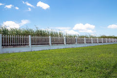 Beautiful of fence factory in industrial estate,green field and Royalty Free Stock Image
