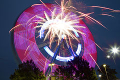 Beautiful Ferris Wheel and fireworks at night TX Royalty Free Stock Photos