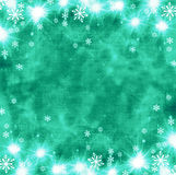 Beautiful festive abstract grunge background with snowflakes and shining stars. Stock Image