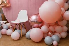 Free Beautiful Festive Decorations, Pink And Grey Balloons, White Chair On Wooden Round Background. Little 1 Year Old Girl Birthday Stock Images - 200014834