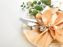 Beautiful festive Easter table setting. With ribbon on white background Royalty Free Stock Photography