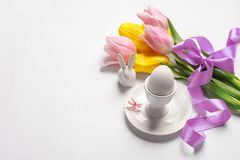 Beautiful festive Easter table setting. On white background Royalty Free Stock Image