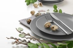 Beautiful festive Easter table setting with eggs. On white background, closeup Stock Photography