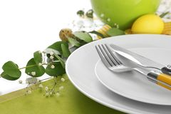 Beautiful festive Easter table setting with eggs. On white background, closeup Royalty Free Stock Images