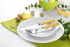 Beautiful festive Easter table setting with eggs. On white background, closeup Royalty Free Stock Image
